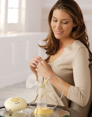 woman with electric breastpump