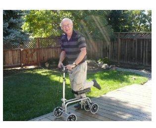 man on knee walker